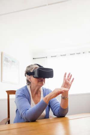 rift: Senior woman using an oculus rift in a retirement home