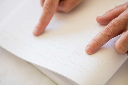 braille: Blind senior woman using braille to read in a retirement home