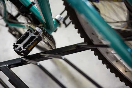 pedal: Close up of pedal and wheel bike in bikeshop LANG_EVOIMAGES