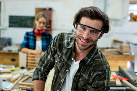 carpenter's bench: Portrait of smiling male carpenter in workshop