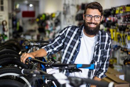 repair shop: Bike mechanic checking bicycles in bike repair shop