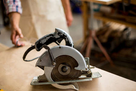 electric saw: Close-up of electric saw in workshop