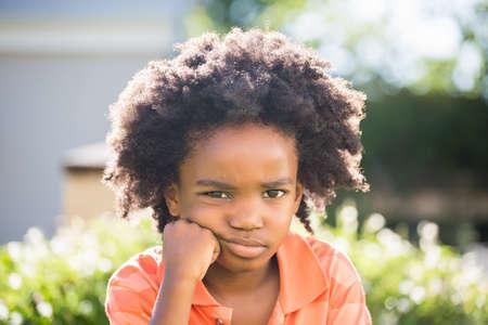 wistfulness: Boy is feeling sad outside