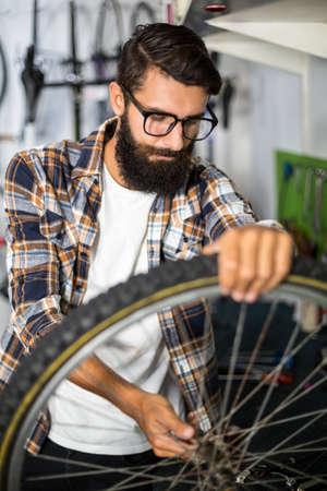 repair shop: Bike mechanic checking at bicycle in bike repair shop