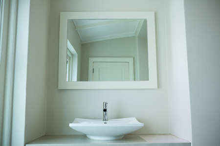 domiciles: White sink and a mirror in bathroom at home