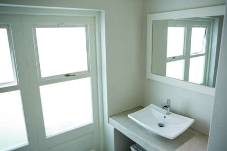 domicile: White sink and a mirror in bathroom at home