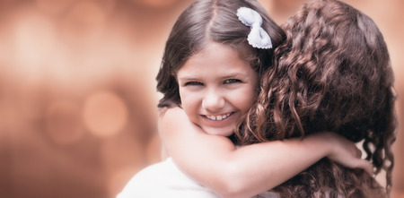 acclamation: Glowing background against happy mother and daughter smiling at camera