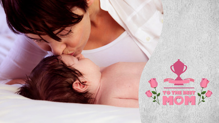 acclamation: mothers day greeting against a mother kissing her baby