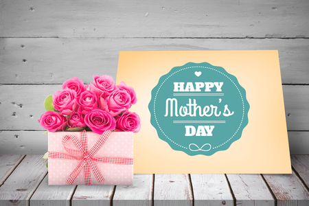acclamation: Gifts in a white background against orange card for mothers day