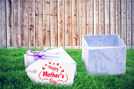 mothers day greeting against wooden background in pale wood Stock Photo