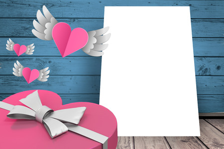 acclamation: Hearts with wings flying on a sheet of paper Stock Photo