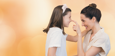acclamation: Colorful background against mother and daughter smiling at each other
