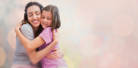 acclamation: Sun is up against mother and daughter hugging