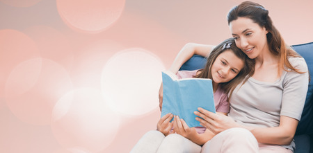 acclamation: Background of multiple color against mother and daughter reading a book