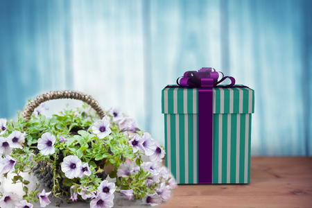 chat room: Blue and silver gift box against a wall Stock Photo