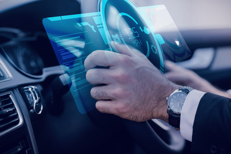 drivers: A watch against businessman in the drivers seat
