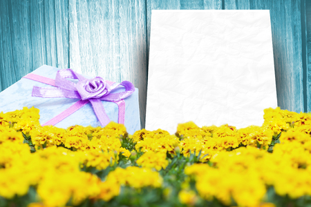 flowered: Gift in a blue background against a wall