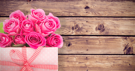 applauding: Gifts in a white background against wooden planks background