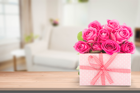 chat room: Flowers and gift against sitting room Stock Photo