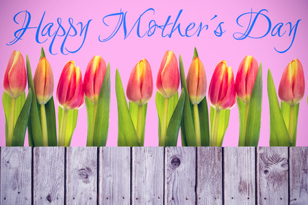 acclamation: Mothers day greeting against wooden planks Stock Photo