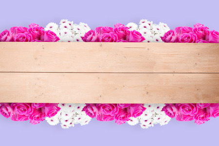 overhead: Pink flowers against overhead of wooden planks Stock Photo