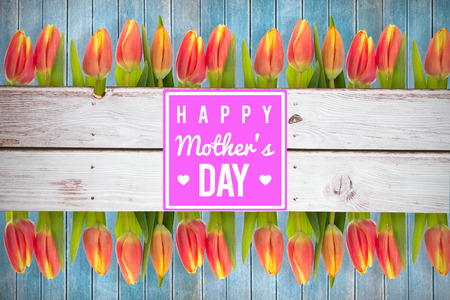 peering: mothers day greeting against wooden planks