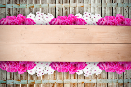 floorboard: Pink flowers against overhead of wooden planks Stock Photo