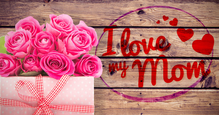 love mom: Mothers day greeting against wooden planks background Stock Photo