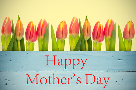 floorboard: Mothers day greeting against painted blue wooden planks