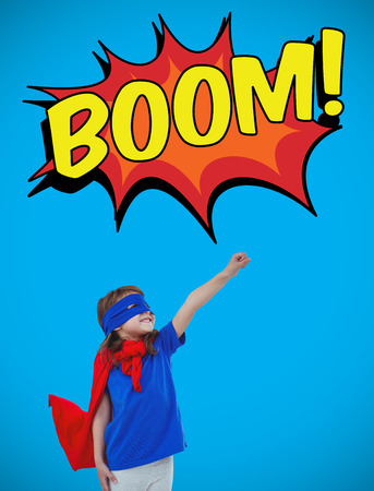 pretending: Masked girl pretending to be superhero against blue background with vignette Stock Photo