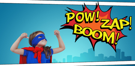 pretending: Masked girl pretending to be superhero against the words pow, zap and boom