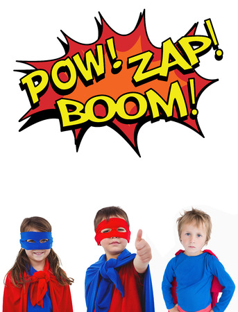 pow: Children dressed as superman against the words pow, zap and boom Stock Photo
