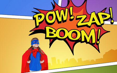 zap: Masked girl pretending to be superhero against the words pow, zap and boom