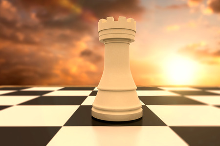 against the sun: White rook on chess board against sun shining Stock Photo