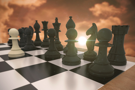 rival rivals rivalry season: Black chess pieces on board with white pawn against a beautiful sunset Stock Photo