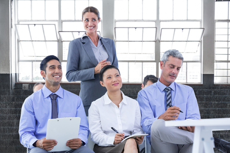 business team taking a note during a meeting  against inside a building Stock Photo