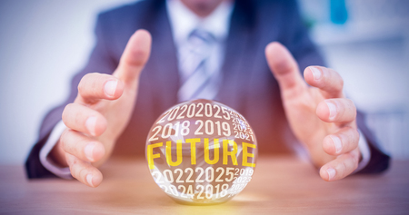 forecasting: The word future against businessman forecasting a crystal ball Stock Photo