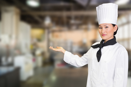 with no one: Confident female cook in the kitchen against no one in the room Stock Photo