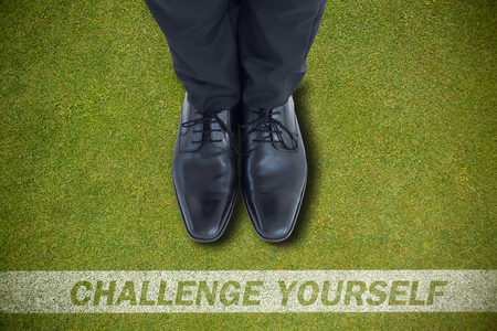 brogues: Businessmans feet in black brogues against green background