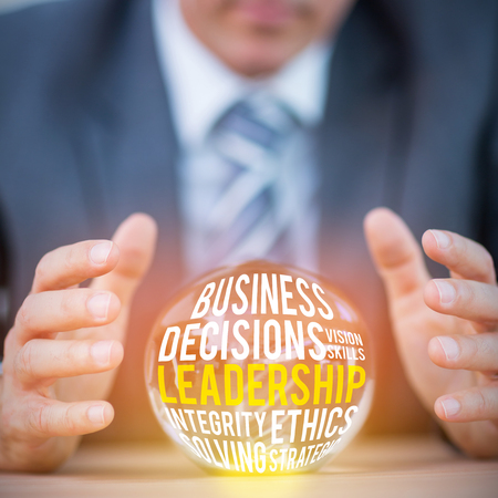 forecasting: The word leadership  against businessman forecasting a crystal ball Stock Photo