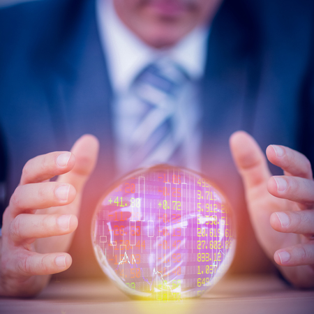 forecasting: Stocks and shares against businessman forecasting a crystal ball