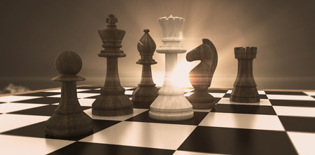 White queen surrounded by black pieces against sky Stock Photo