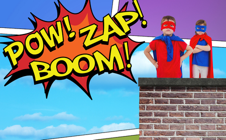 superheroes: Masked kids pretending to be superheroes against the words pow, zap and boom Stock Photo