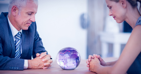 clairvoyant: Stocks and shares against two business people thinking with a crystal ball