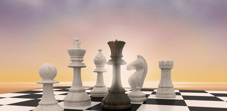 surrounded: Black queen surrounded by white pieces against sunset sky Stock Photo