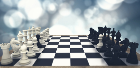 Black and white chess pawns defecting against blue sky