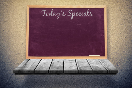 composite image: Composite image of blackboard with todays specials message on a wooden shelf Stock Photo