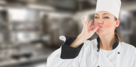 satisfying: Portrait of a woman chef satisfying against a cooker
