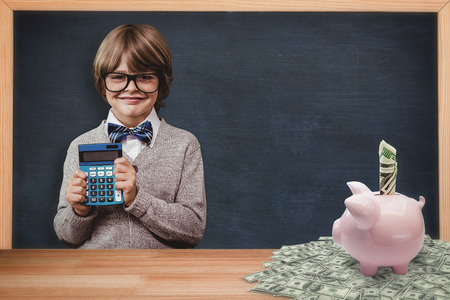 pupil: Pupil with calculator against dollar in piggy bank