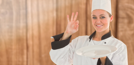 satisfying: Portrait of a satisfying chef and holding an empty plate against overhead of wooden planks